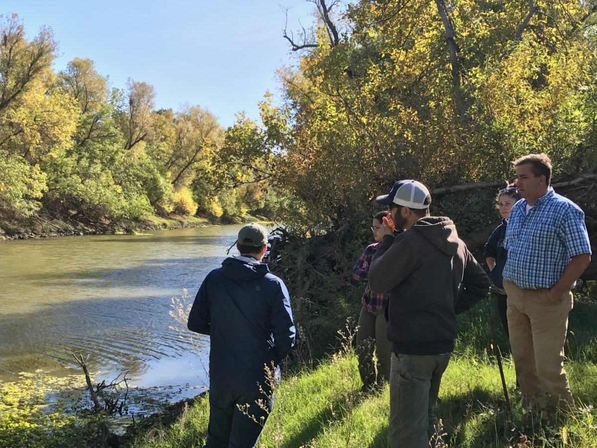 Photo of the project team visiting the Tule Canal. This is where the salmon will end up shortly after exiting the rice fields for their final passage to the Sacramento River.