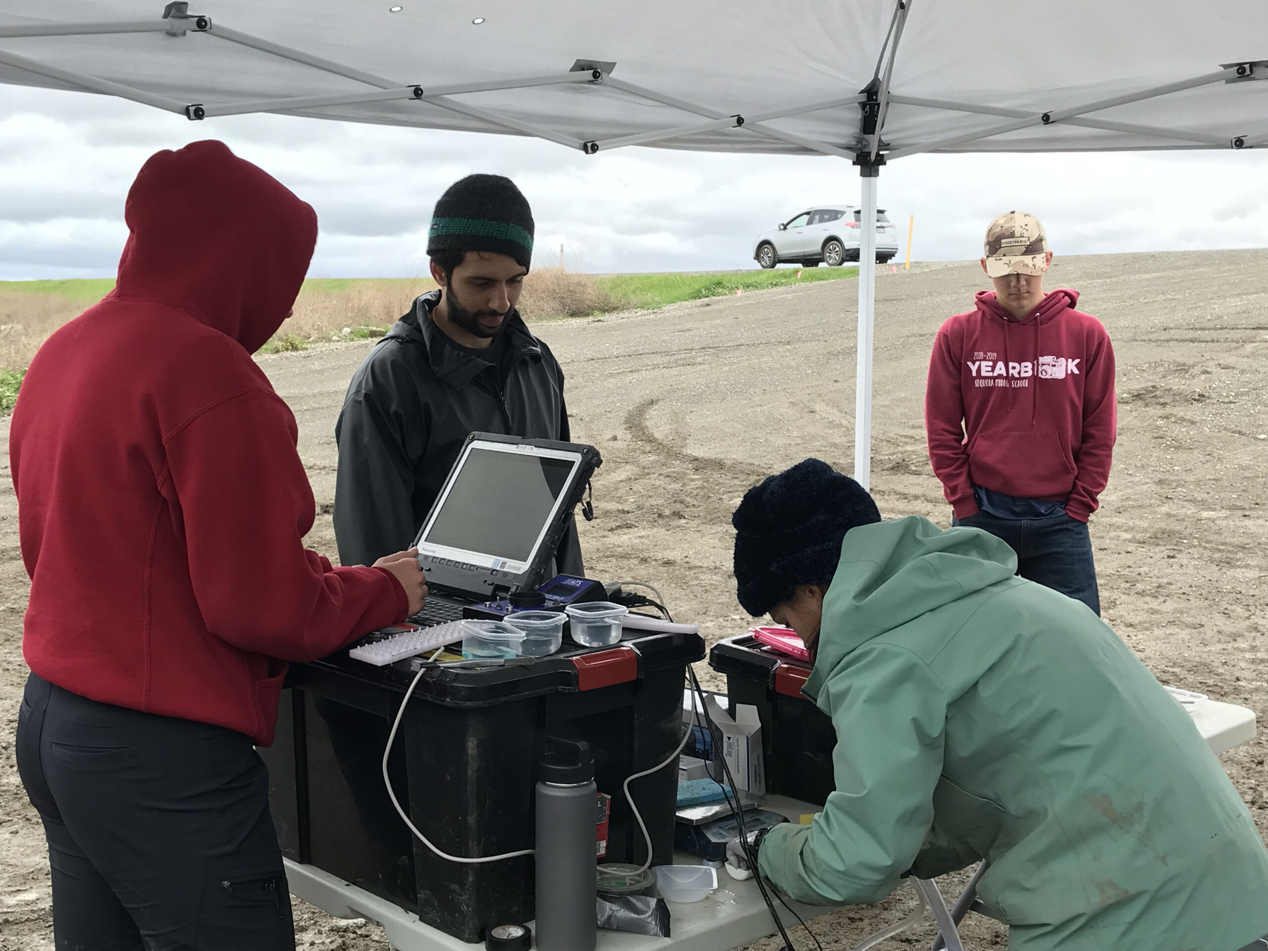 UC Davis fish surgery team all ready to get to work tagging fish and recording all the data.